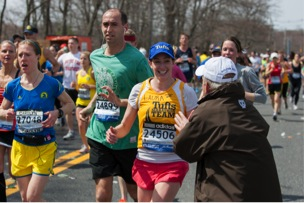 Coach Don Megerle cheers on Laura at mile 9. (Source: Tufts Photography)