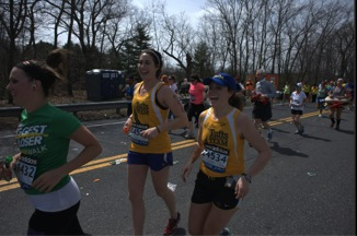 Kalyn Weber and Meg Keegan at mile 9 where Coach Don and Kayln's parents were cheering them on. (Source: Tufts Photography)