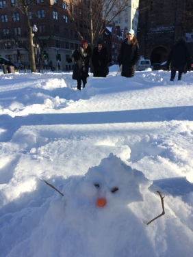 Grace Goodwin immortalizes students' tiny snowman in a photo!