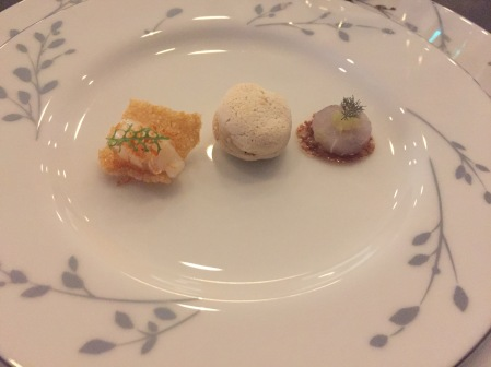 Welcoming Bites: Scallop, roe, sake, bonito rice; Black olive, almond, duck liver; Cured hake, orange sesame, lime