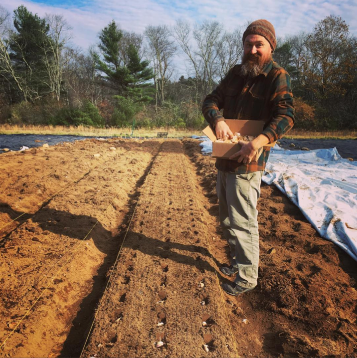Alex seeing Assawaga Farm's first crop - garlic! (Photo: Instagram @assawagafarm)